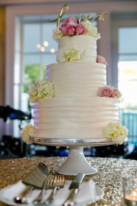 Cakes by Liz provided the couple with a traditional wedding cake and a groom's cake. – Photo by Randi Baird